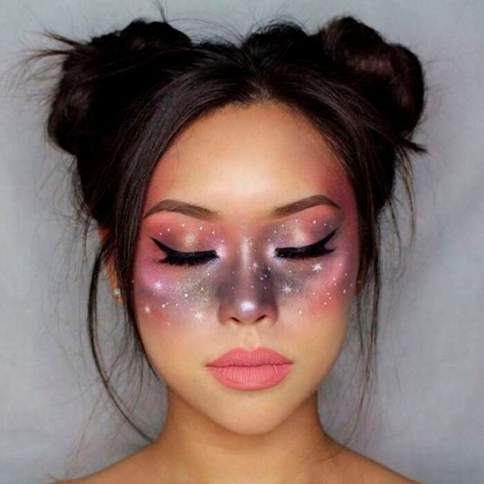 Creative makeup with purple and pink colors