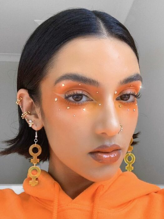Creative makeup with orange and white colors