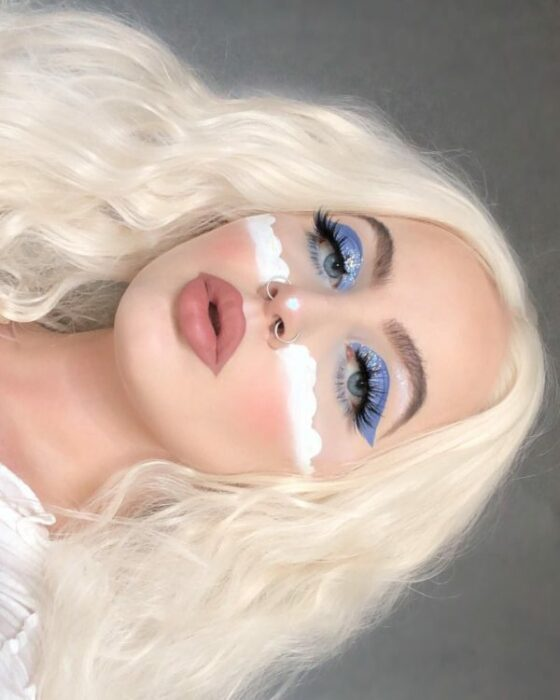 Creative makeup with blue and white colors