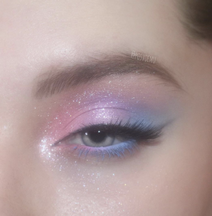 Girl with a pink, purple and blue glitter eye makeup