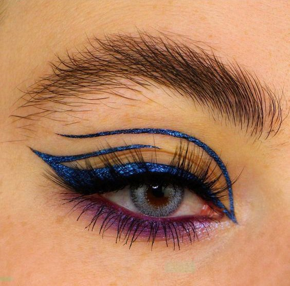 Girl with an eye makeup in blue tones with a purple outline
