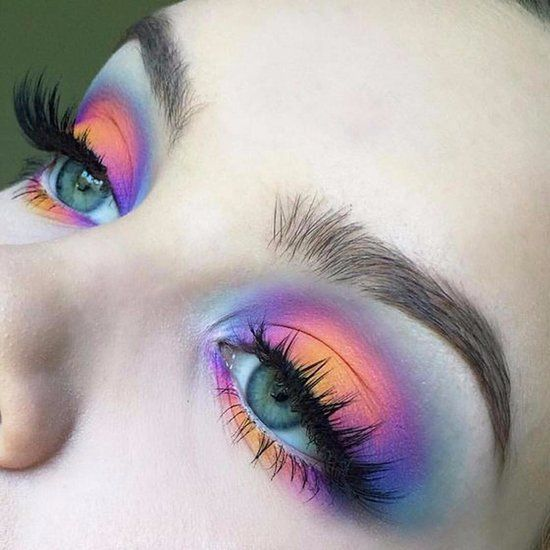 Girl with an eye makeup in various shades of yellow, pink and purple