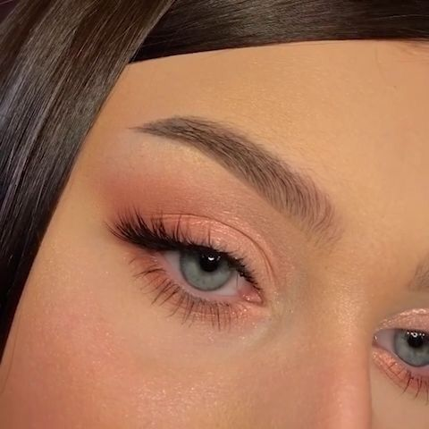 Girl with a natural eye makeup in pink tones