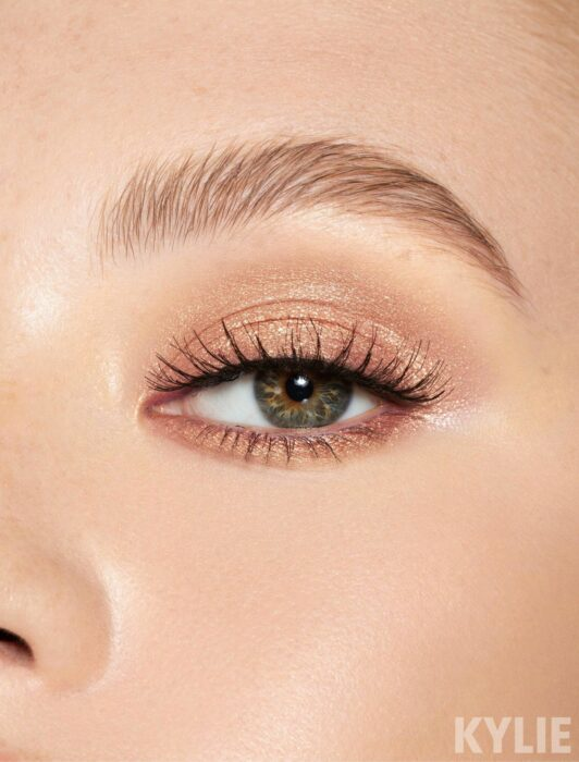 Girl with a very natural gold and pink eye makeup