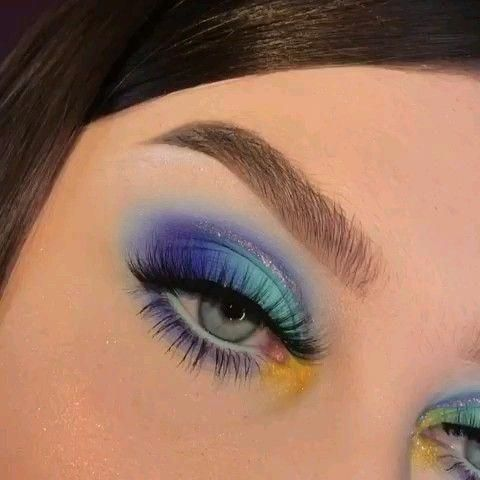Girl with an eye makeup in blue and yellow tones