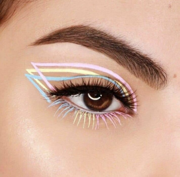 Girl with a multi-colored eyeliner makeup