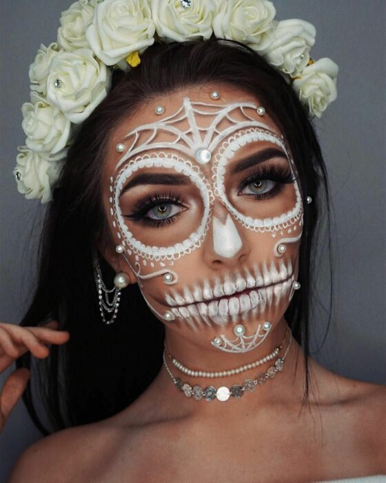 Girl with a catrina makeup in white colors