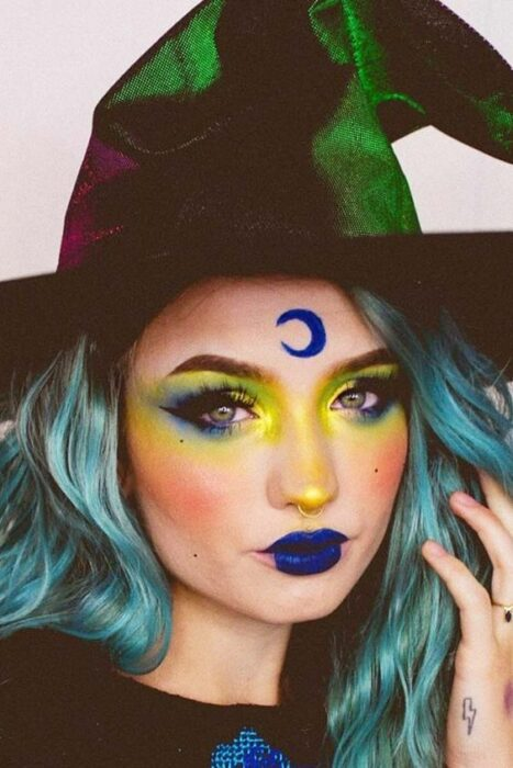 Girl made up as a witch