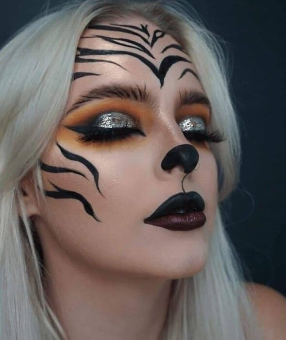 Girl made up as a tiger