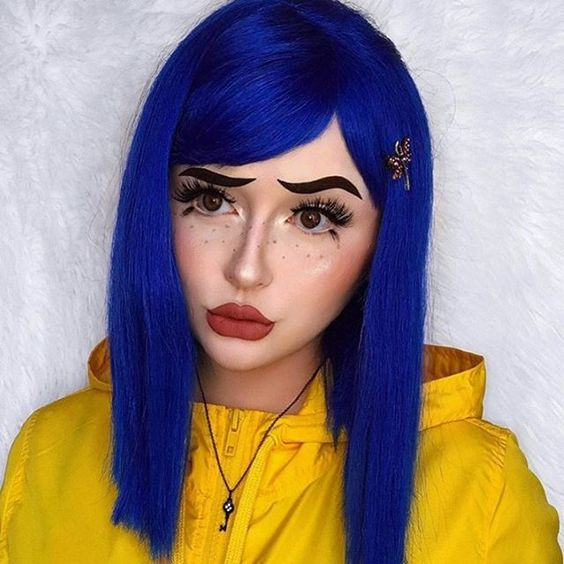 Girl made up as Coraline