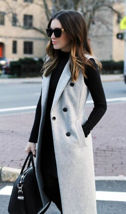 Outfit for the autumn-winter office of black jeans and sweater, and beige wool vest