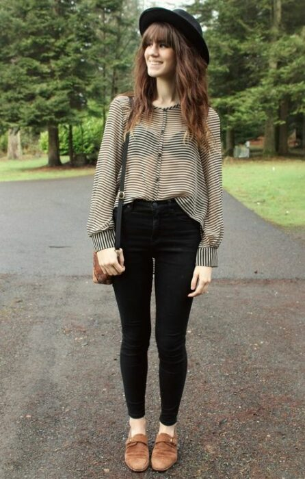 Girl wearing black hat with camel moccasin outfit, black jeans and white gauze blouse with black polka dots