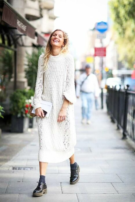 Girl wearing a total white look of ankle boots and loose knit dress