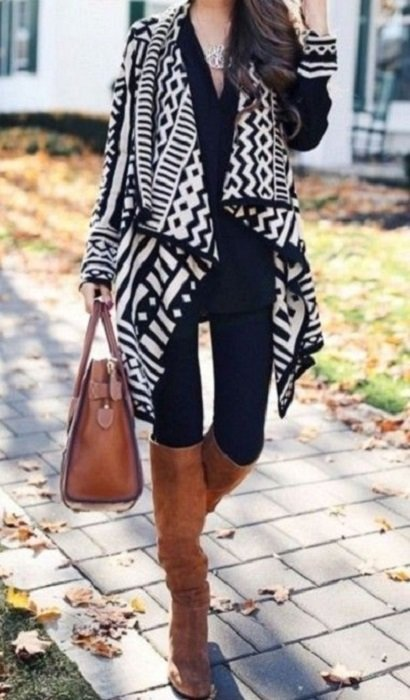 Outfit for the autumn-winter office of black with white, blouse and black jeans, boots and camel bag