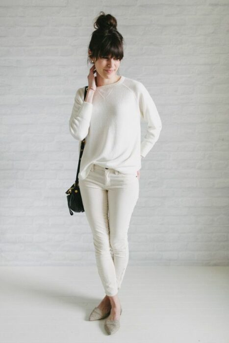 Girl wearing a total white look pants, jeans and white blouse