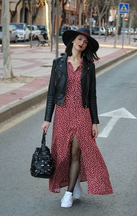 Girl wearing black hat with white tennis outfit, red maxi dress with polka dots and black leather jacket