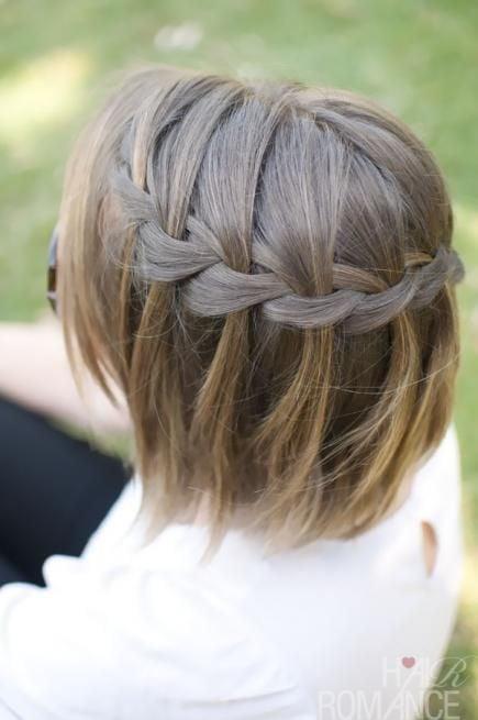 girl with short hair braided as a headband