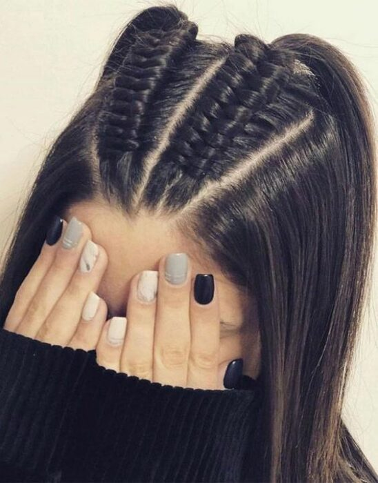 Girl with half ponytail with two braids