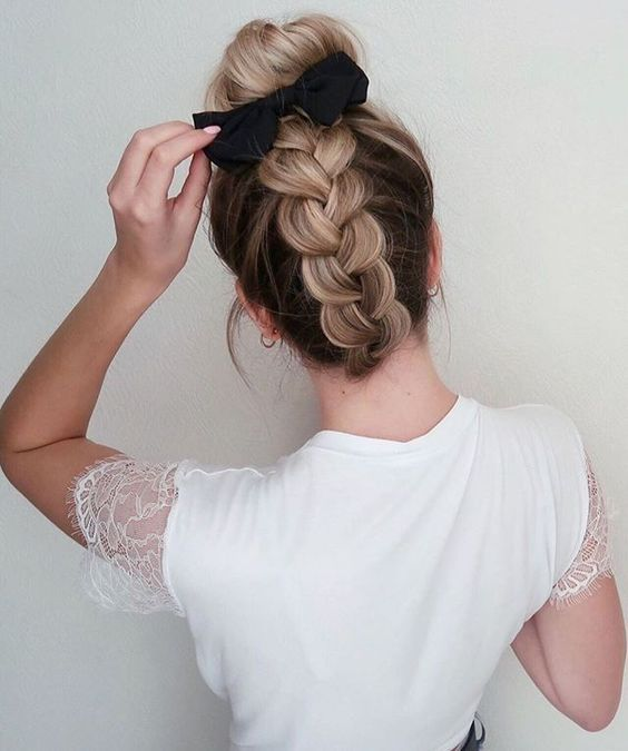 girl with reverse braid and a black bun