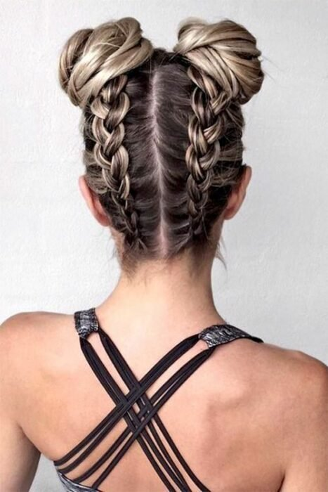 Girl with double bun decorated with reverse braids