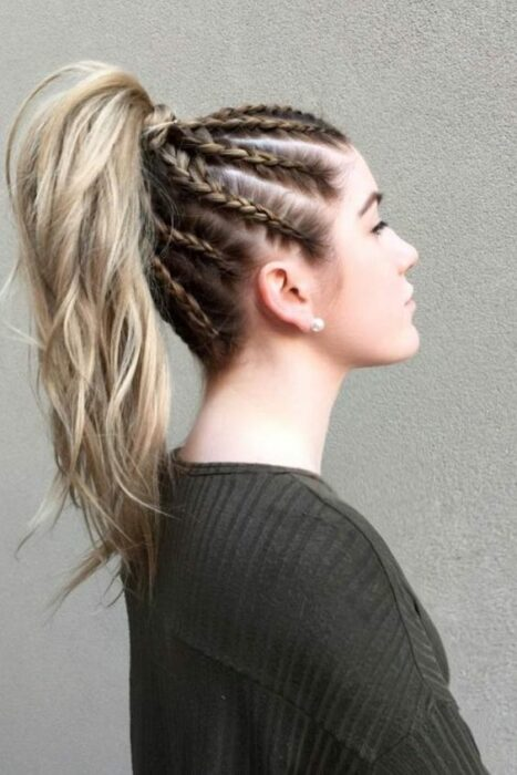 girl with hair braided in half ponytail