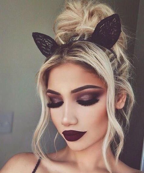 Girl with makeup and a headband made of deer ears
