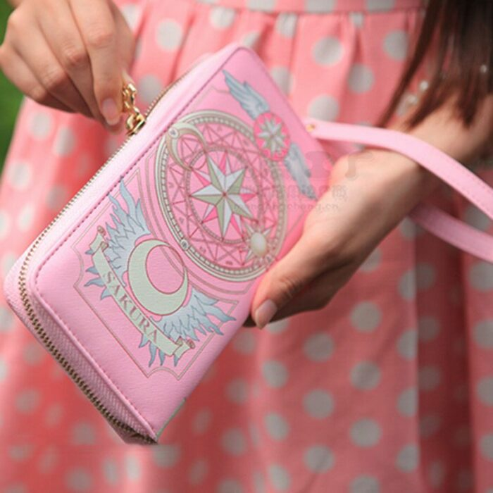 Cartera de mano en color rosa inspirada en sakura card captor