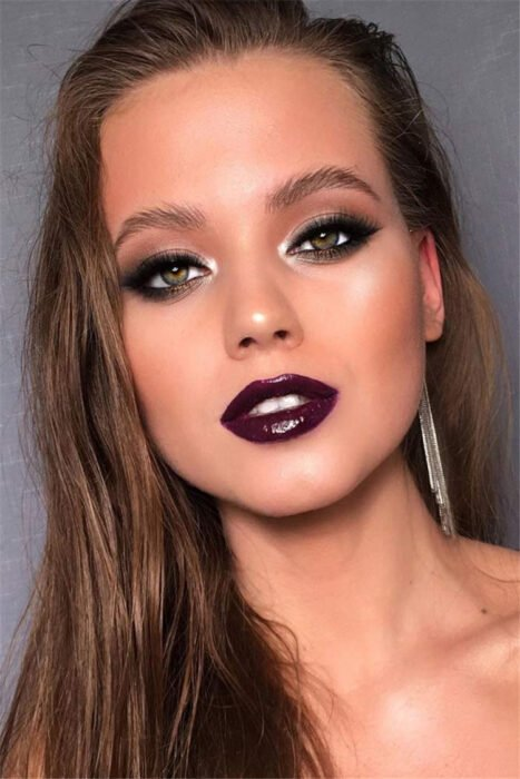Girl with Smoke Eyes style makeup with shades of black with pink