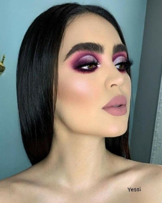 Girl with eyes made up in the Smoke Eyes style in purple tones