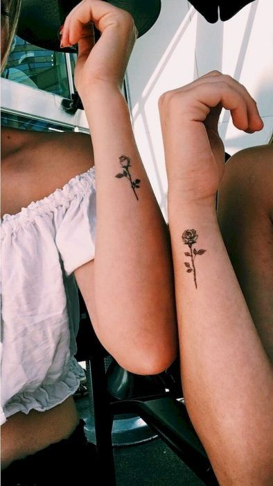 Complementary tattoo of a rose on the forearm area