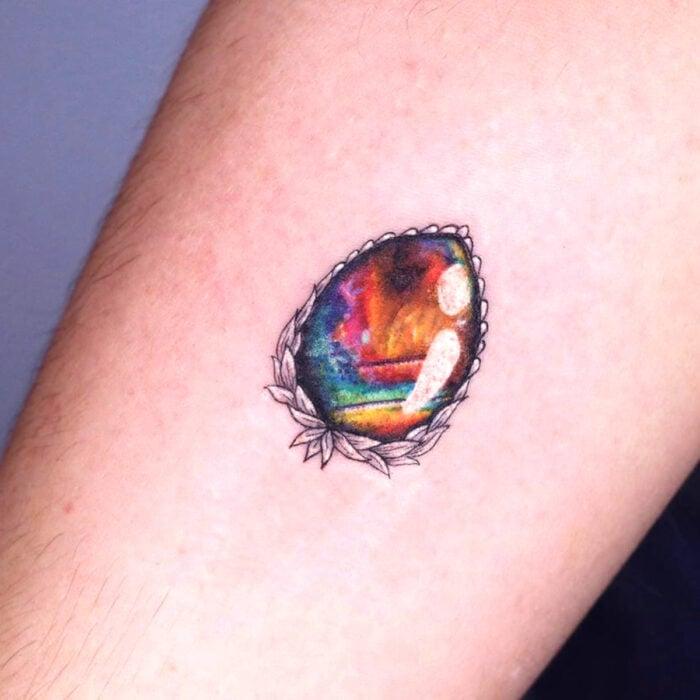 Pretty rainbow jewel tattoo designs on the arm