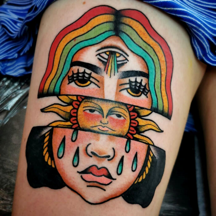 Pretty old school face tattoo designs with rainbows on the leg