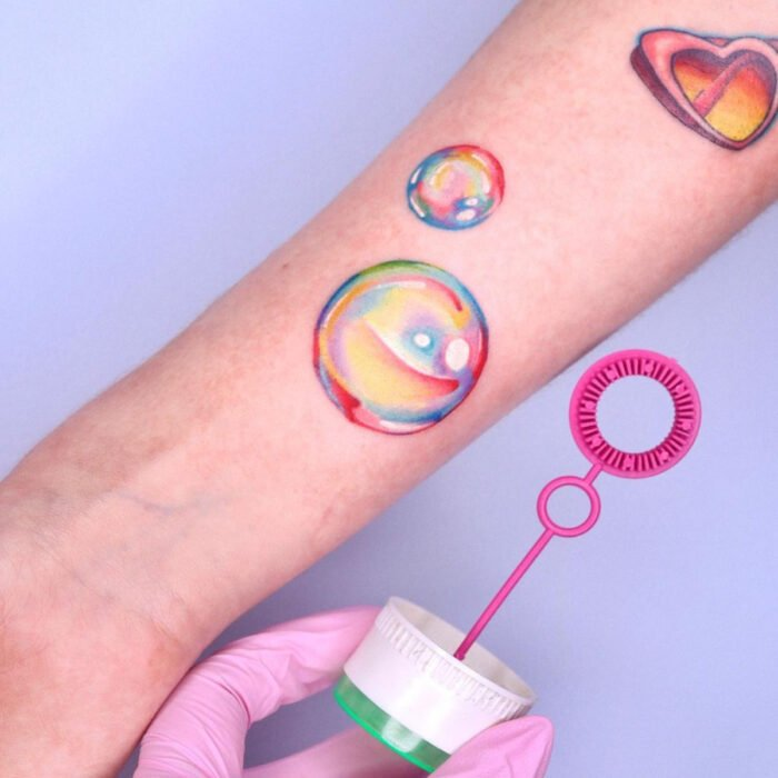 Pretty Rainbow Soap Bubble Tattoo Designs on Arm