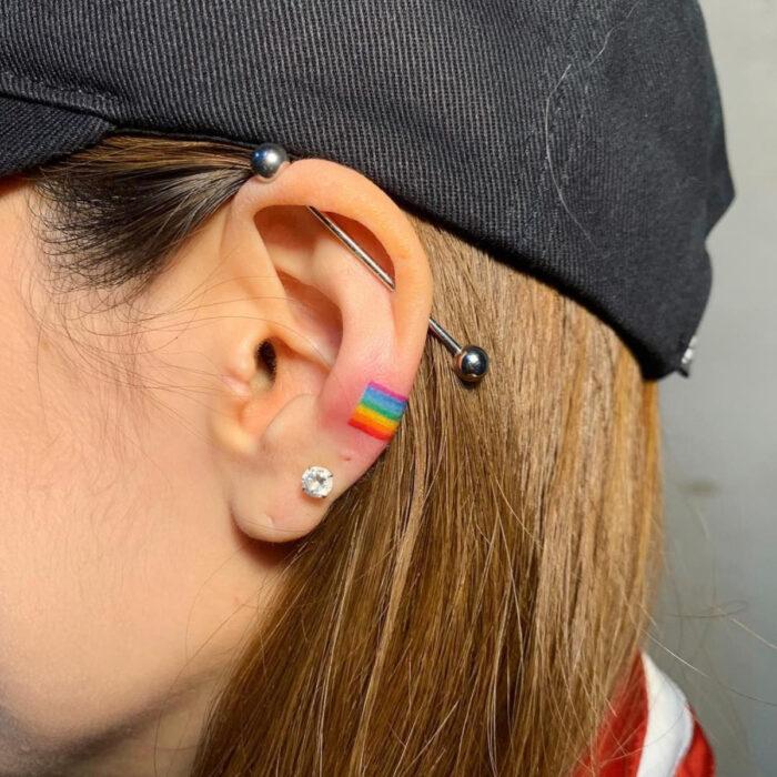 Pretty rainbow ear tattoo designs