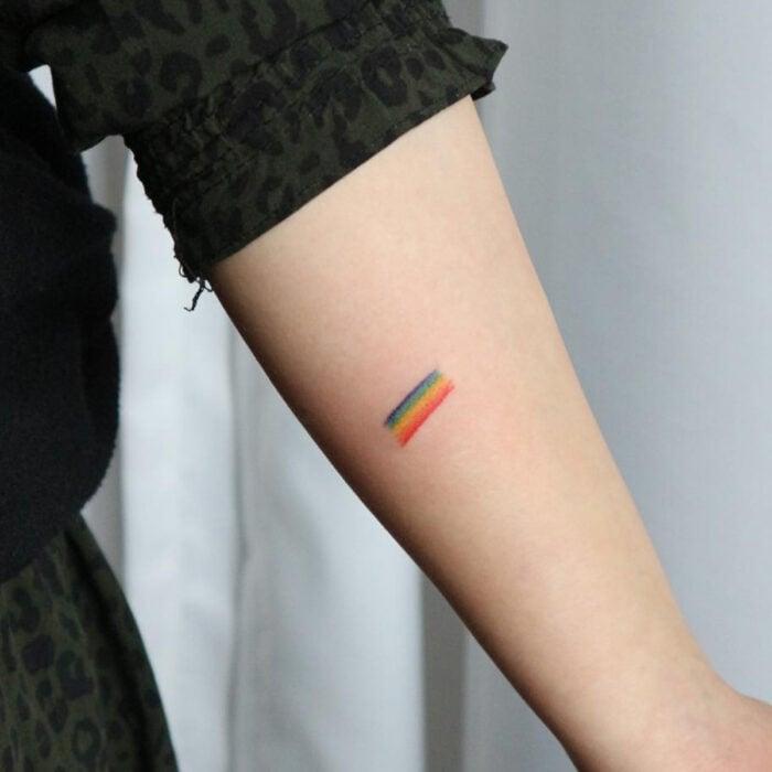 Pretty rainbow tattoo designs on the arm