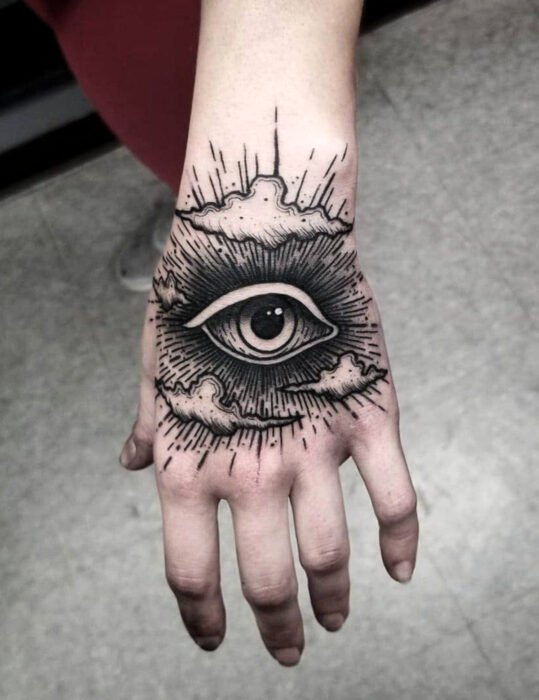 Original tattoo designs; eye with lines, tattoo on hand