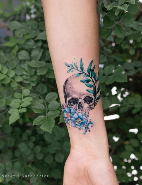 Original tattoo designs; skull with flowers, wrist tattoo