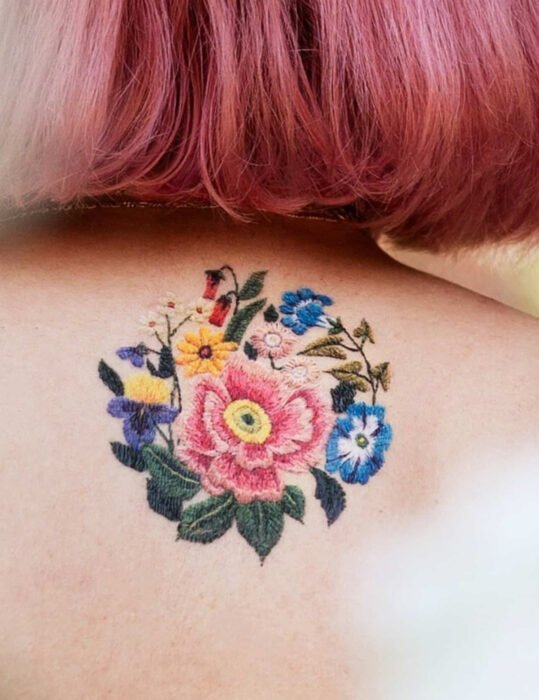 Original tattoo designs; Woven flower tattoo on back
