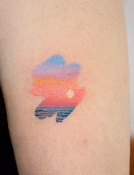 Original tattoo designs; Beach sunset landscape brushstroke arm tattoo