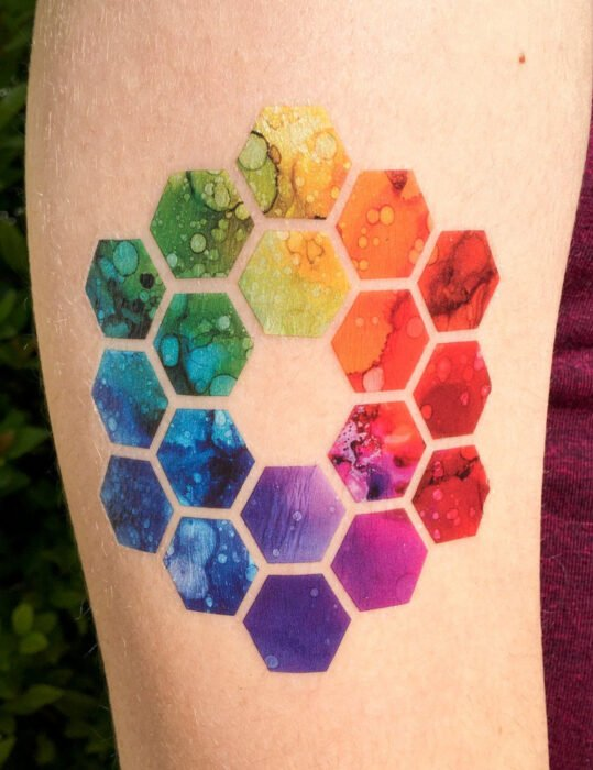 Original tattoo designs; chromatic circle tattoo, rainbow colored hexagons; geometric tattoo on arm