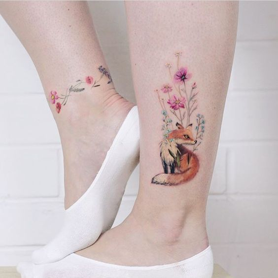 Colorful flower tattoo on the ankle