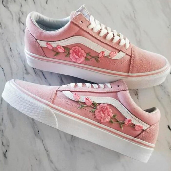 Pink Vans, with pink roses on the outer side