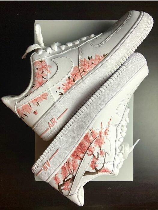 White tennis shoes with hand painted pink cherry blossoms