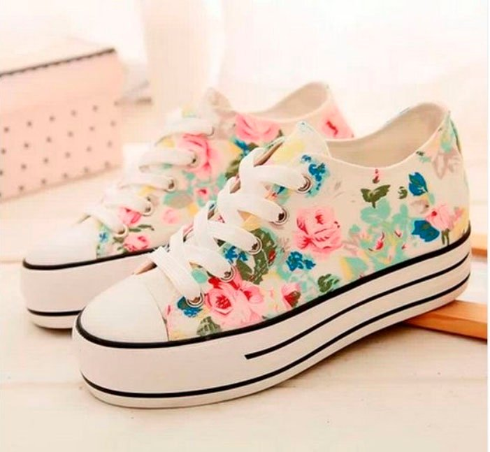 White tennis shoes with hand painted pink and blue flowers