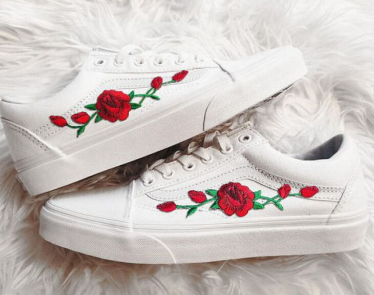 White vans with red roses on the outer side