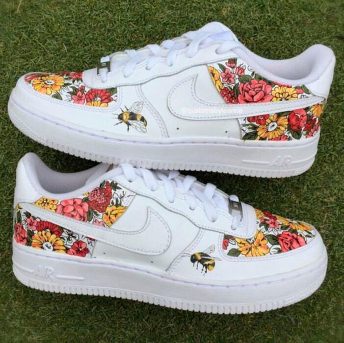 White tennis shoes with flowers especially the teni in pink and yellow colors hand painted