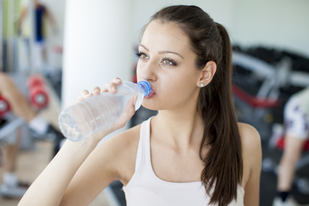 Girl drinking natural water