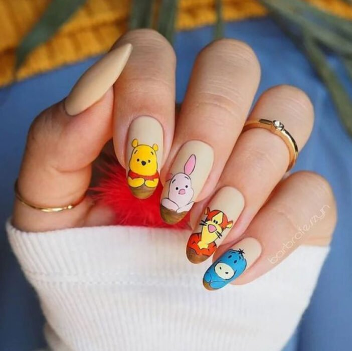 Disney-inspired manicure from the movie 'Winnie the Pooh'