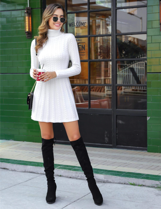 Girl wearing a long knitted dress in white color