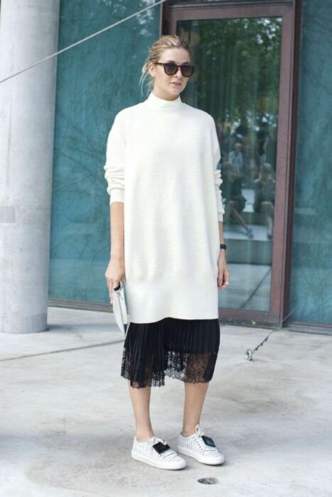 Girl wearing a long knitted dress in white with black